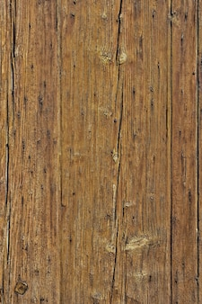 Old cracked faded wood board background vertical