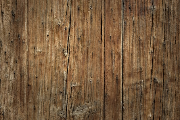 Old cracked faded wood board background