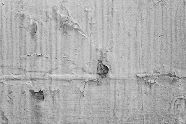 古いひびさびたペンキ背景テクスチャクローズアップ黒と白