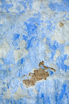 Old cracked and shabby blue wall for background.