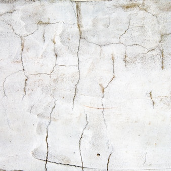 Old cracked white wall background