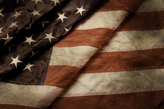 Old and creased us flag. aged flag of us. time doesn't stand still. past won't blur the way.