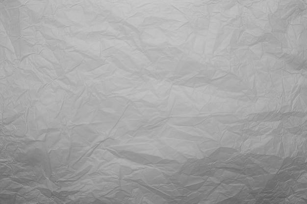 오래 된 구겨진 된 회색 종이 벽 텍스처
