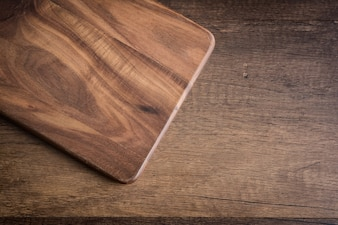 Old Cutting Board on wooden table.