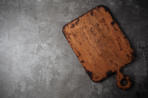 Old cutting board on table.
