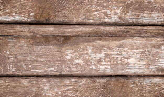 古い暗くて素朴な木製の背景。木製のテーブルまたは床。
