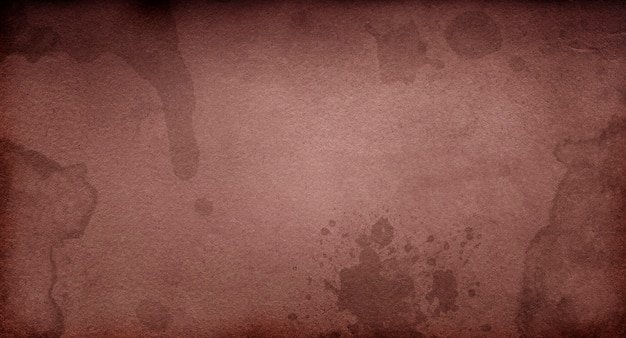 Old dark brown grunge paper with spots and streaks for design