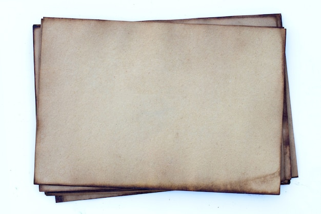 Старый темно-коричневый фон текстуры бумаги.