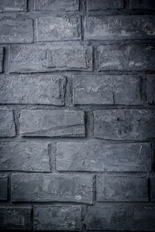 Old dark grey brick wall, background