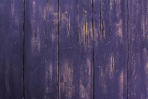 Old dark grunge wooden background with nails