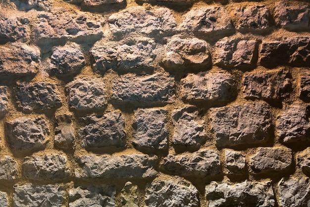 Старый темный фон каменной стены