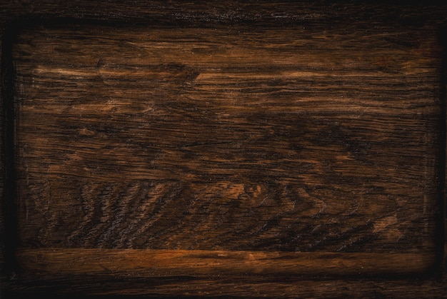 Old dark wooden surface copy space top view