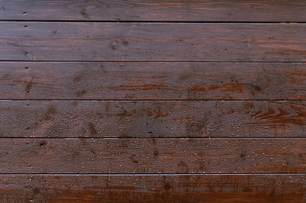 Old dark wooden wall with raindrops background texture