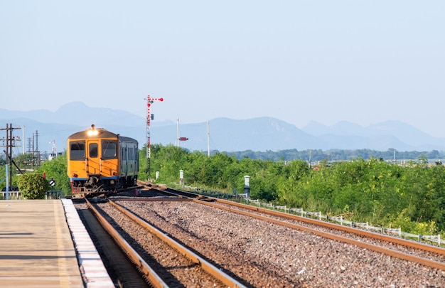 Old diesel multiple unit of the local train is arriving at the station in the northeast line, thailand.