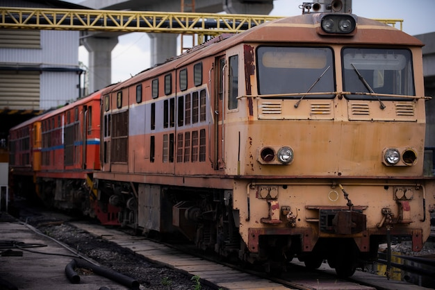 Old diesel train locomotive at the railway station. vintage train staying on the railroad