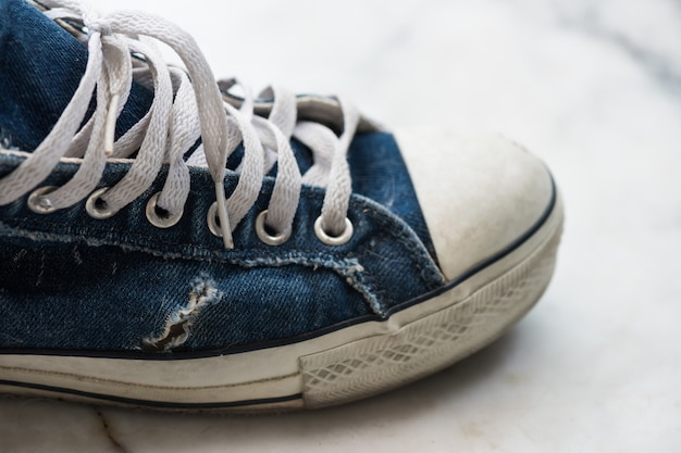 Old dirty blue sneaker. teenager fashion