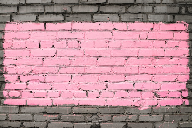 Old dirty brick wall painted in pink