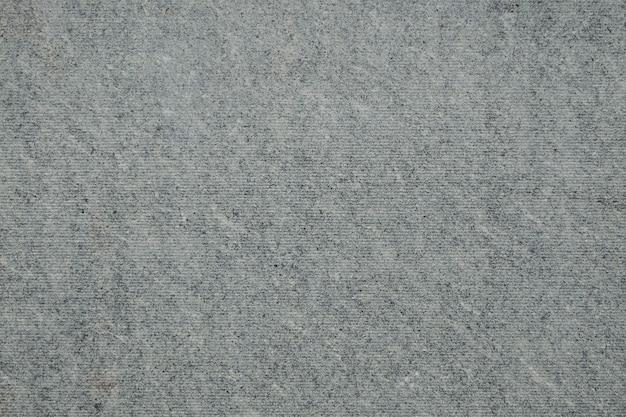 古い汚れた平らなスレート表面の背景テクスチャ。汚れた古い平らなスレート、むらのある震えシートの表面、抽象的な背景のテクスチャ
