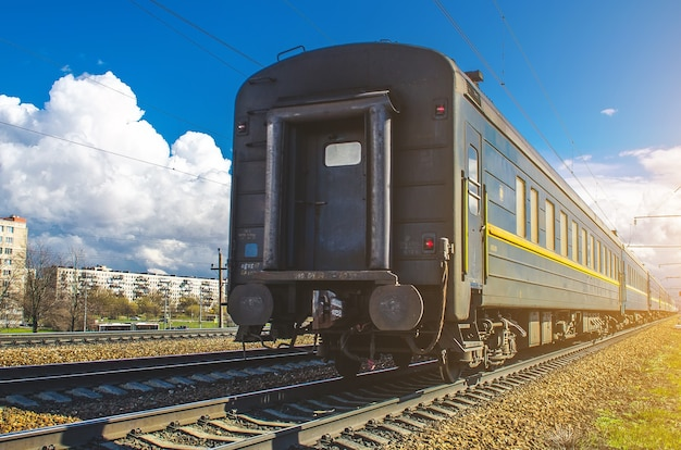 Old dirty passenger train cars on station in russia.