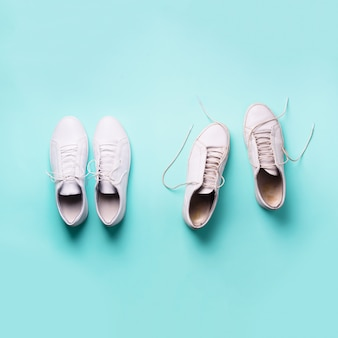 Old dirty sneakers vs new white sneakers. trendy footwear.