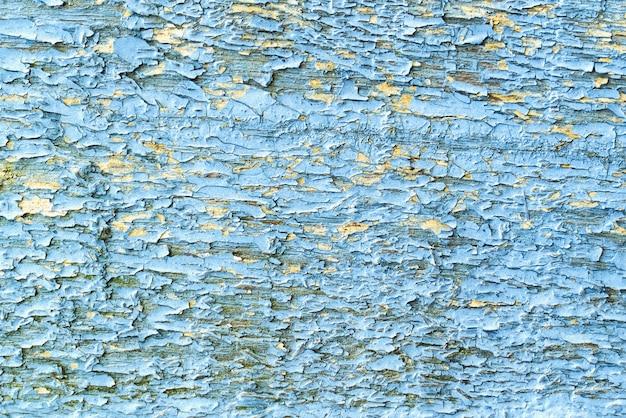 亀裂のある古い汚れた木製の青い背景。抽象的な背景。上面図、テキスト用のコピースペース