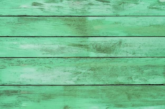 古い汚れた木製の緑の背景。抽象的な背景。上面図、テキスト用のコピースペース