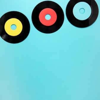 Old disc records on blue background