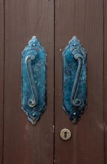 Old door handle and oak wooden classic style