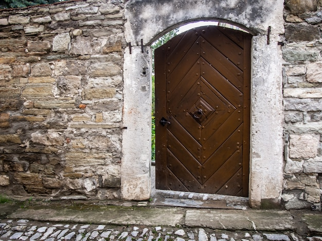 Old door in a stone wall close-up.