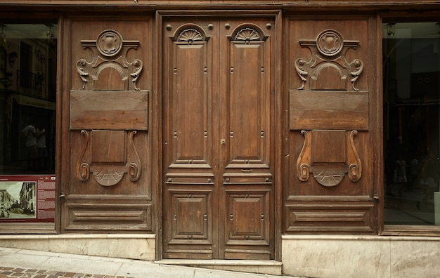 Old door of a wooden shop belonging to the historic center of cagliari in sardinia, italy