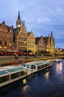 Old embankment of ghent with tourboats moored,  belgium