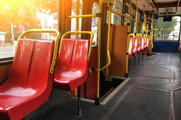 An old empty tram with no people in the cabin