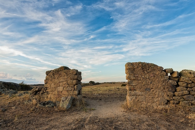 Old entrance of a ruined pen in the pasture in spain