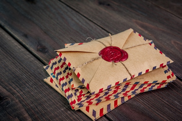 Old envelopes with a wax stamp on a wooden table
