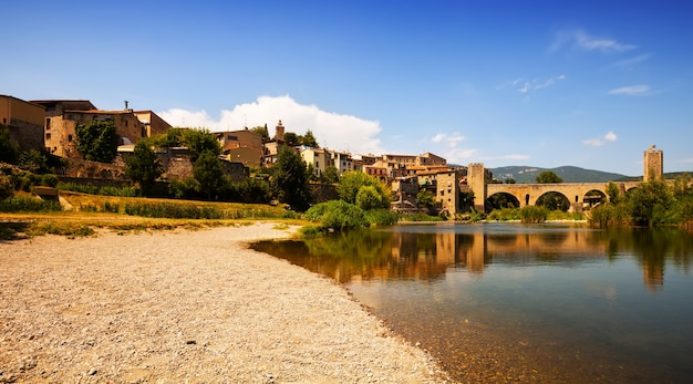 Old european town with antique bridge over  river