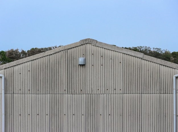 Old factory metal plate wall facade gable roof.