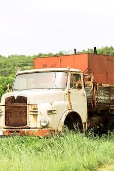 Old farming car on field