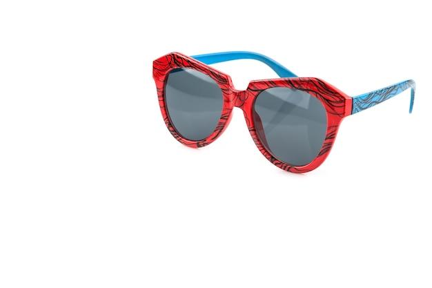 Old fashion orange and blue sunglasses isolated on white background