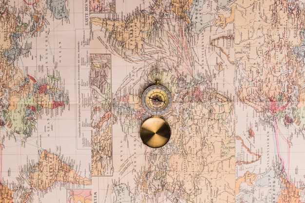Old fashioned compass on maps