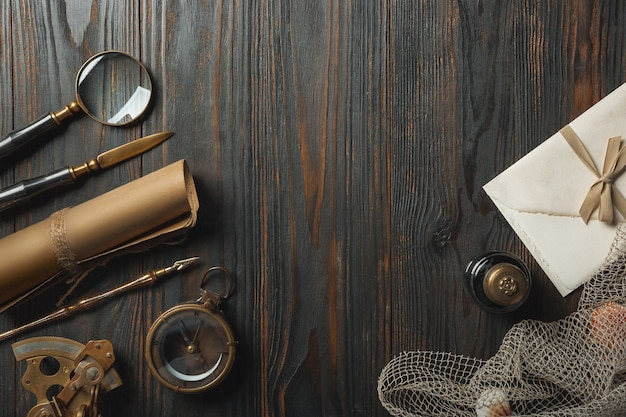 Old fashioned flat lay with letters writing accessories on dark wooden background