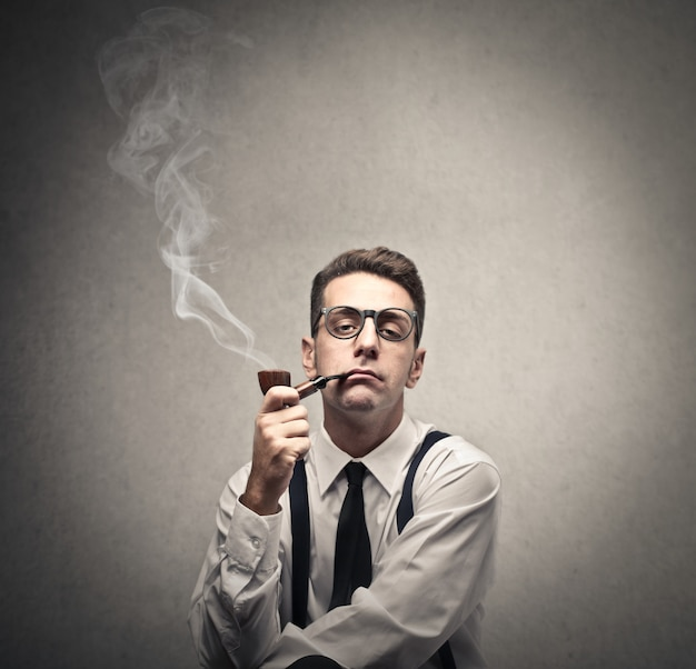 Old-fashioned man smoking a pipe