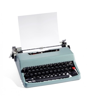 Old fashioned manual typewriter with blank paper