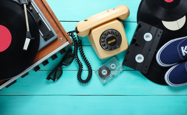 Old-fashioned objects on a blue wooden background. retro style, 80s, pop culture. top view