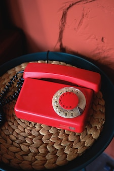 Old-fashioned red phone in beautiful retro interior.