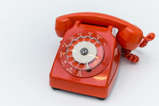 Old fashioned red rotary telephone