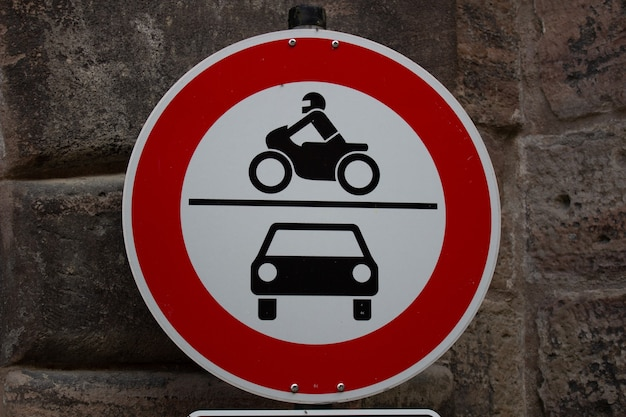 Old fashioned traffic sign no motor vehicles cars and motorbikes in red, white and black