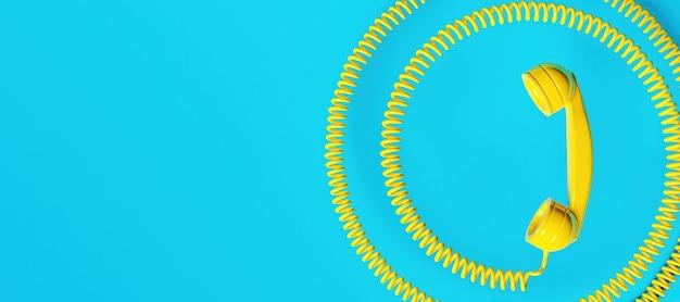 코일 코드와 텍스트를위한 공간 구식 노란색 전화 송수화기