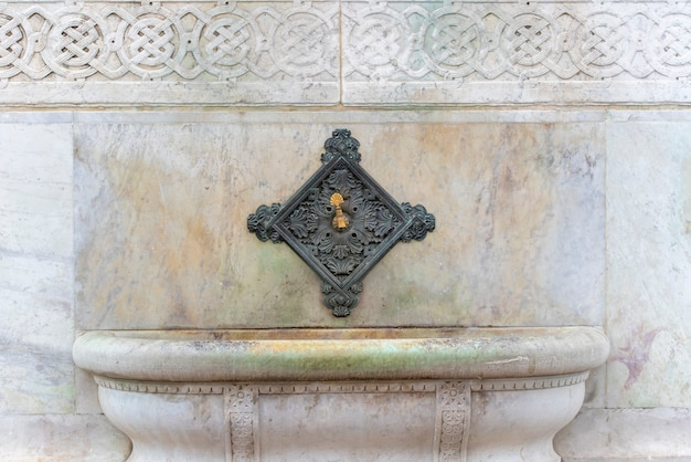 Old faucet or washbasin at mosque for ablution before praying in istanbul