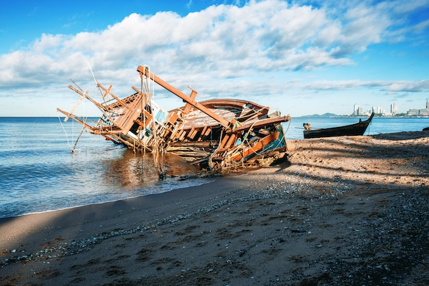 Old fishing boat on beach.