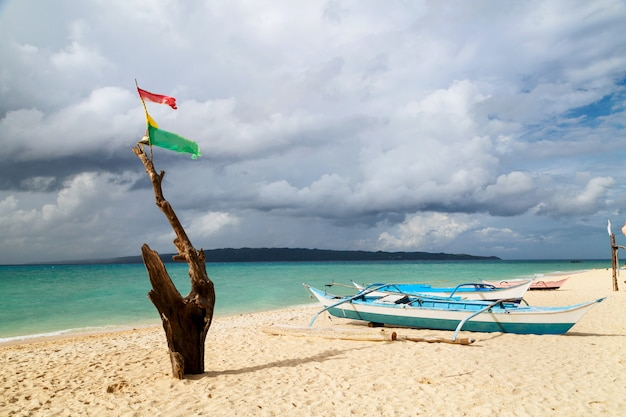 Old fishing boats color standing on the sandy beach